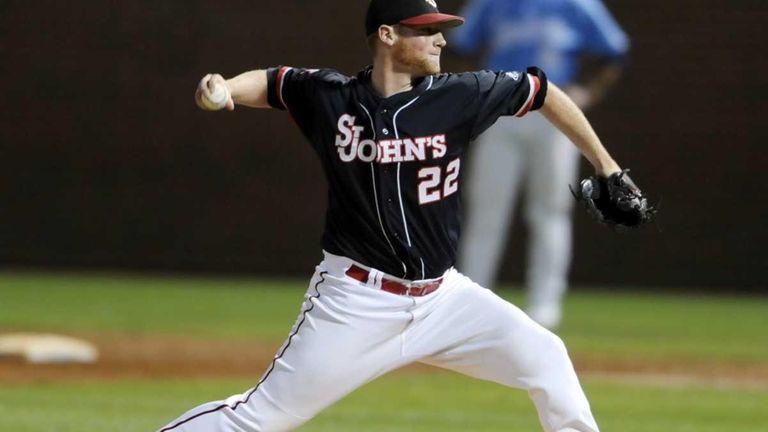 St. John's Stephen Rivera (22) pitches to North