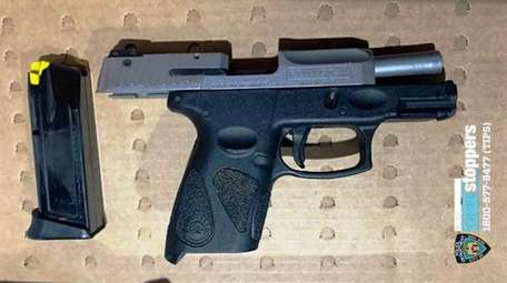 The 9mm semi-automatic Taurus handgun recovered from suspect