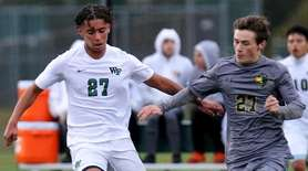 Ward Melville midfielder Jovanny Ortiz and William Floyd
