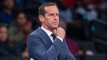 Nets coach Kenny Atkinson looks on during a