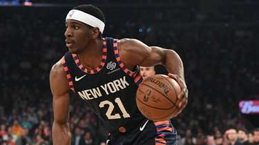 Knicks guard Damyean Dotson drives the ball against