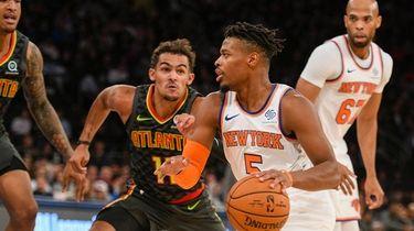 Atlanta Hawks guard Trae Young (11) defends Knicks