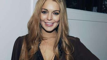 Lindsay Lohan attends the Eva Fehren Jewelry Show
