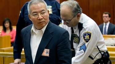 Dr. Stan Li enters a court room on