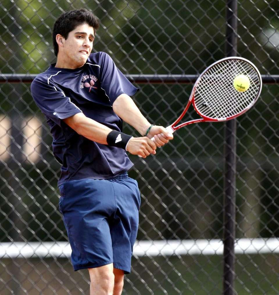 Cold Spring Harbor's Conor Dauer with the backhand
