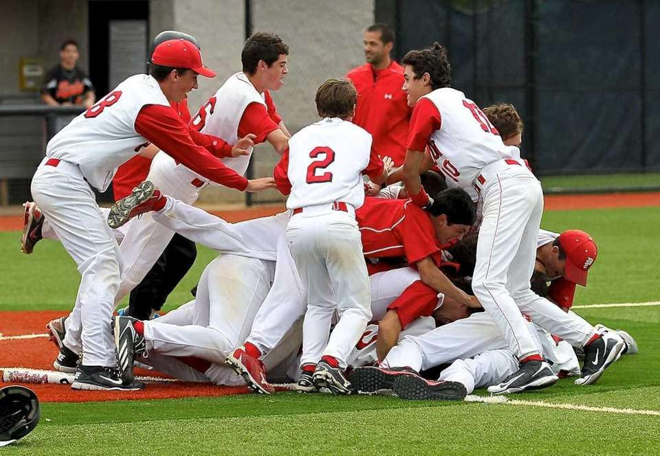 Pierson celebrates their 1-0 victory at home plate