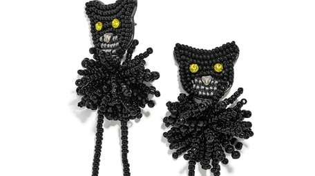 Earrings with sparkly, yellows eyes, a puffy beaded