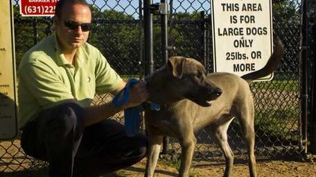 Jeff Redelman, of Melville, with his dog Grayson
