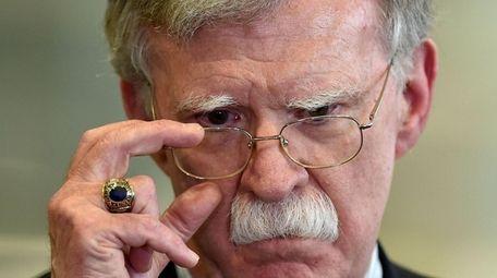 Then-U.S. National Security Advisor John Bolton answers journalists