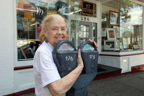 Betty Stephens hugs a parking meter outside her