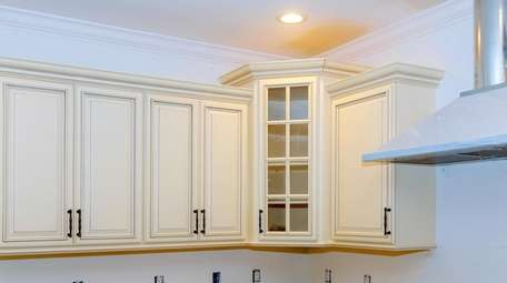 In standard upper cabinets with two or three