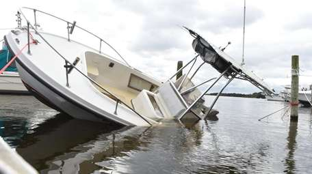 A boat damaged from strong winds overnight at