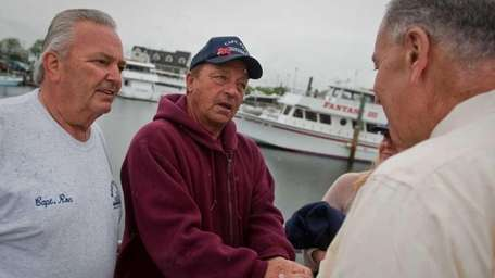 Fishermen Ron Burdewick, left, and Pete DeVita, right,