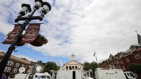Television satellite trucks set up outside the Centre