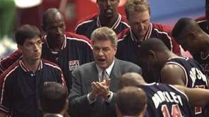 USA basketball coach Chuck Daly talks with the