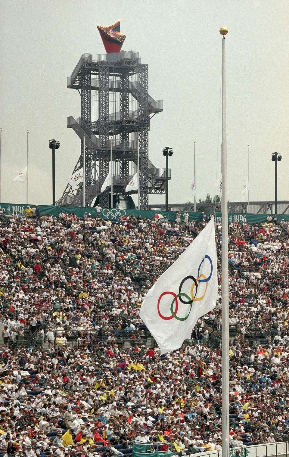 The Olympic flag flies at half staff during