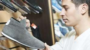 A man choosing shoes during footwear shopping at