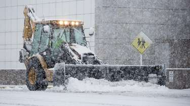 A plow clears snow outside Eastern District Federal