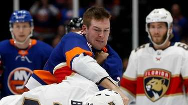 Ross Johnston #32 of the Islanders fights Josh
