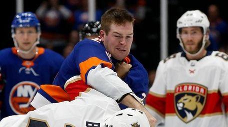 Ross Johnston #32 of the Islanders fights Josh