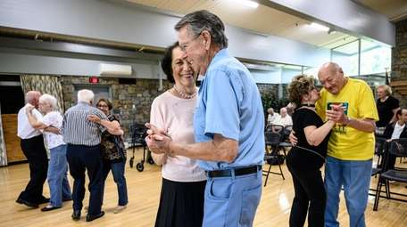 Lenore Jacobs and Don McGuirk practice dance to