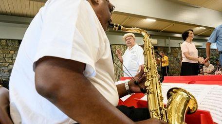 Golden Tone Orchestra director Bobby Ferrari is framed