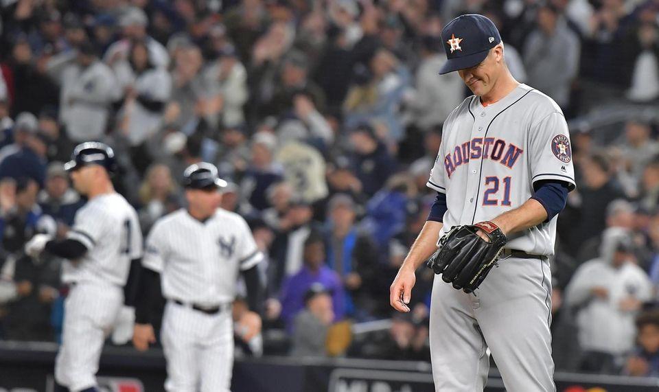 Houston Astros starting pitcher Zack Greinke (21) reacts