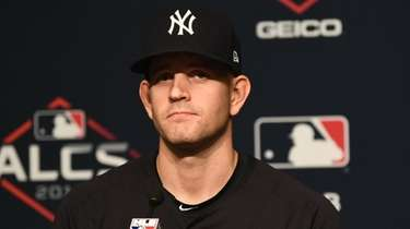 Yankees starting pitcher James Paxton (65) speaks at