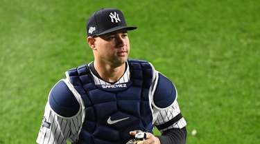 Yankees catcher Gary Sanchez runs into the outfield