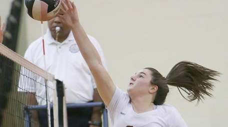 Bay Shore's Caitlin Christie (21) plays the ball