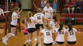 Bay Shore girls celebrate their win during the