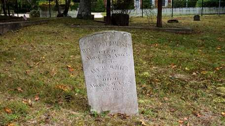 The headstone of the Rev. J.P. Thompson is