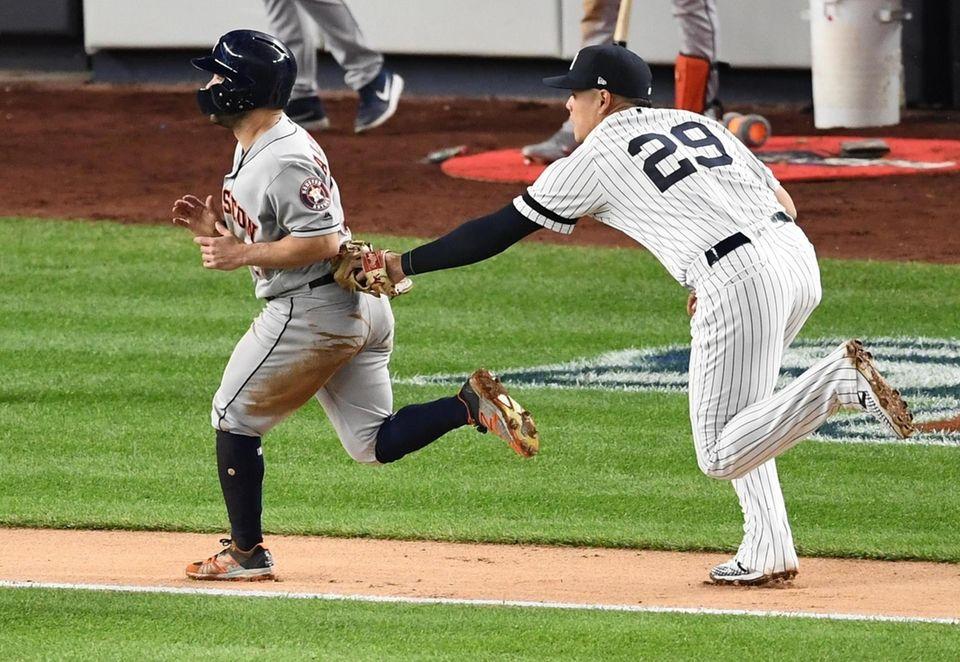 New York Yankees third baseman Gio Urshela tags