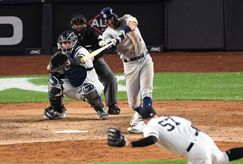 Houston Astros' Carlos Correa hits a three-run home