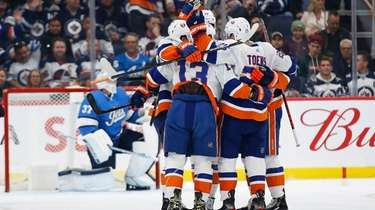 New York Islanders' Mathew Barzal (13) and teammates