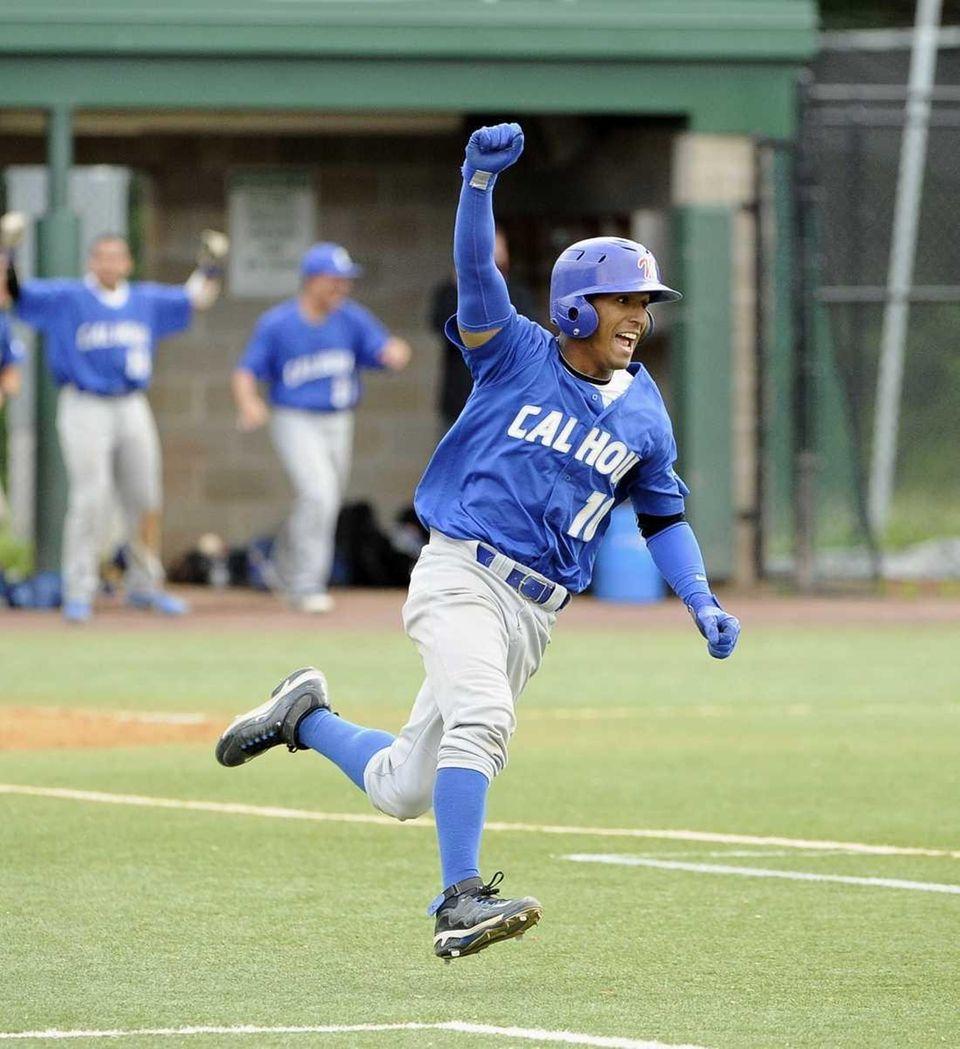Calhoun's Alex Vargas reacts to his game-winning two-run