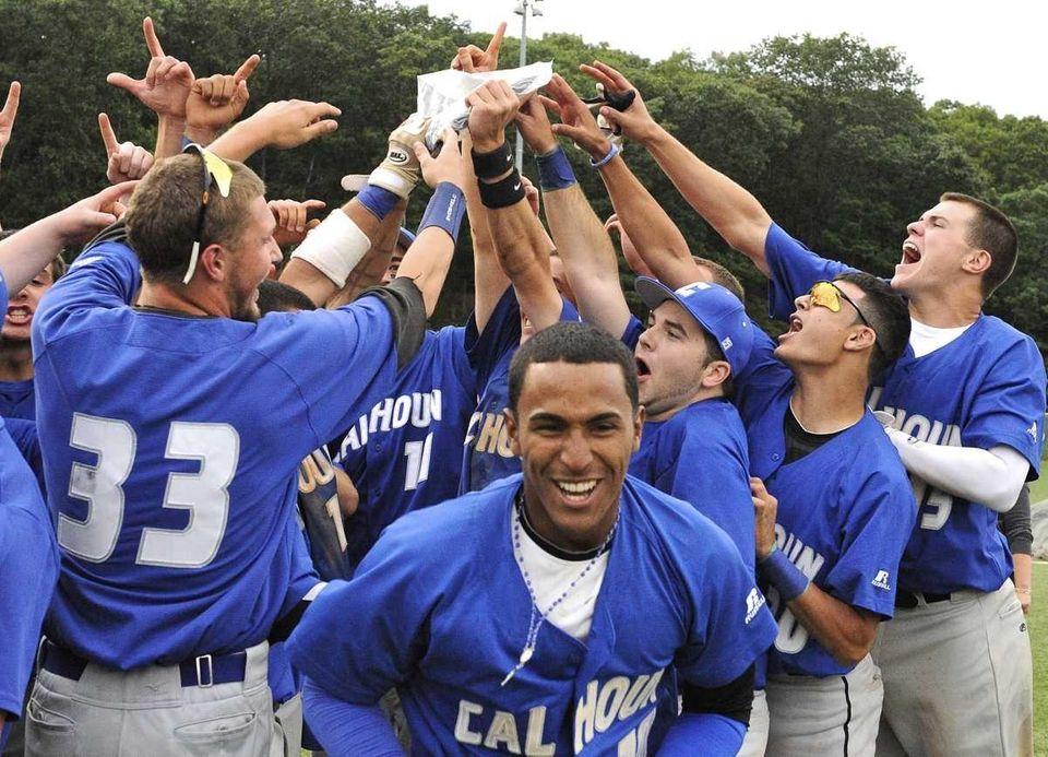 Calhoun's Alex Vargas, center facing, and his teammates