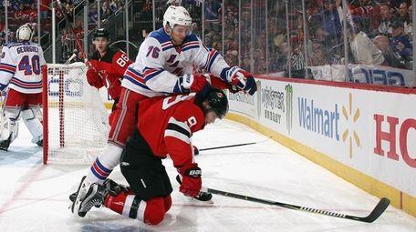 Brady Skjei #76 of the Rangers jumps on