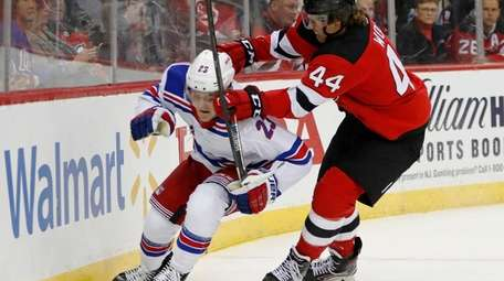 New Jersey Devils left wing Miles Wood (44)
