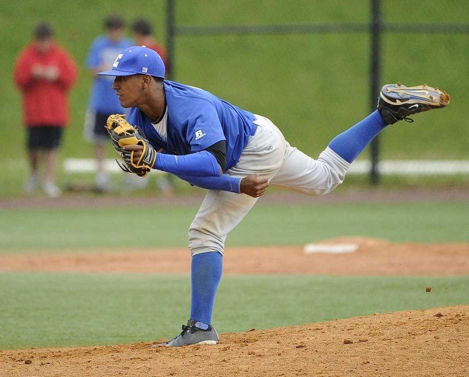 Calhoun pitcher Alex Vargas follows through on a