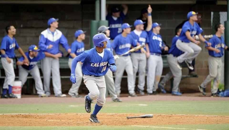 Calhoun's Alex Vargas (10) and his teammates react