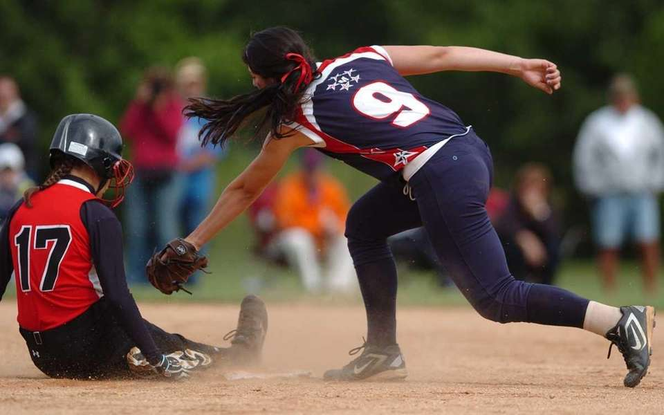 MacArthur shortstop Jena Cozza reaches to tag East