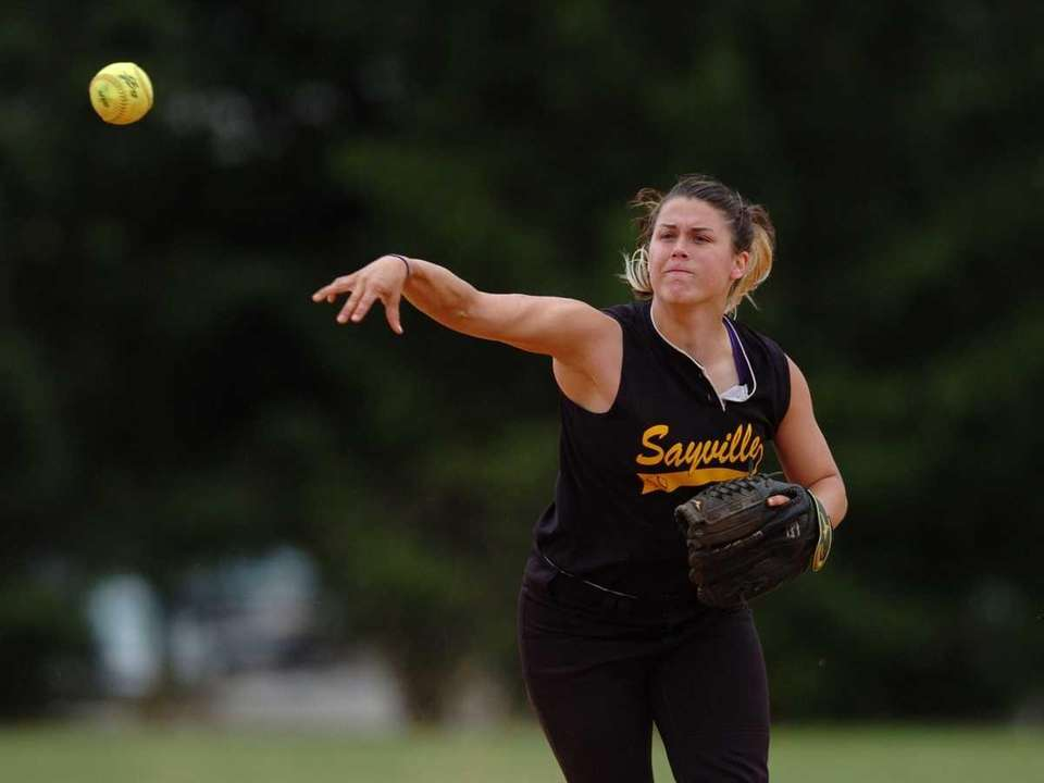 Sayville shortstop Emily Sellitti throws to first base