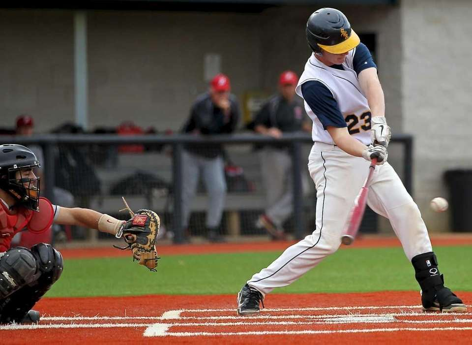 Shoreham-Wading River's Mike O'Reilly makes contact against Plainedge