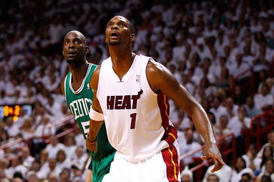Chris Bosh of the Miami Heat fights for