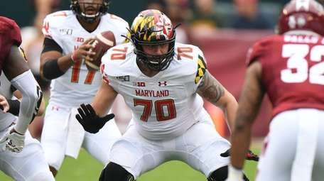 Sean Christie of Maryland looks to block a