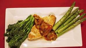 Swordfish is served with caponata, broccoli rabe and
