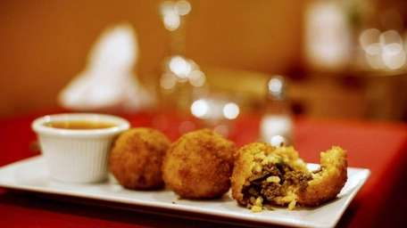 The arancini, fried rice balls with a beef