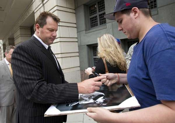 Former Major League Baseball pitcher Roger Clemens, left,