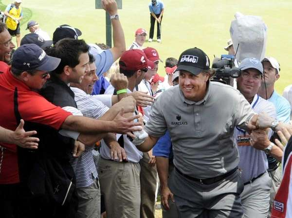 Phil Mickelson makes his way past adoring fans